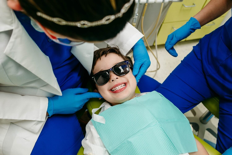 Kids checking teeth