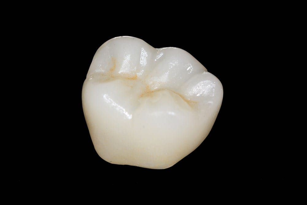 zirconia crown on a black background