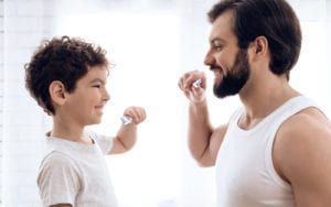 Father and Child Brushing