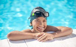 Smiling Kid In Pool