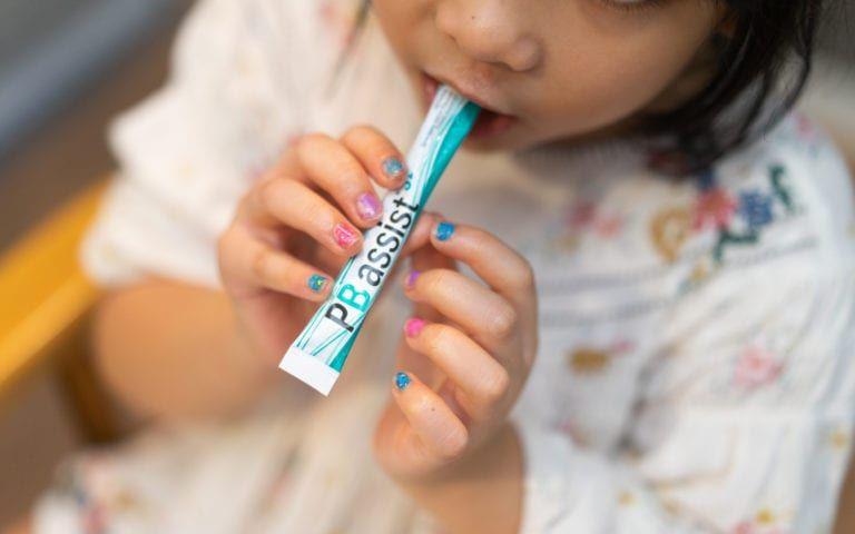 Child taking probiotics